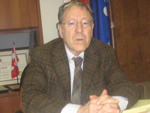 Cotler arms folded